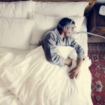 Man sleeping with an anti-snoring mask on